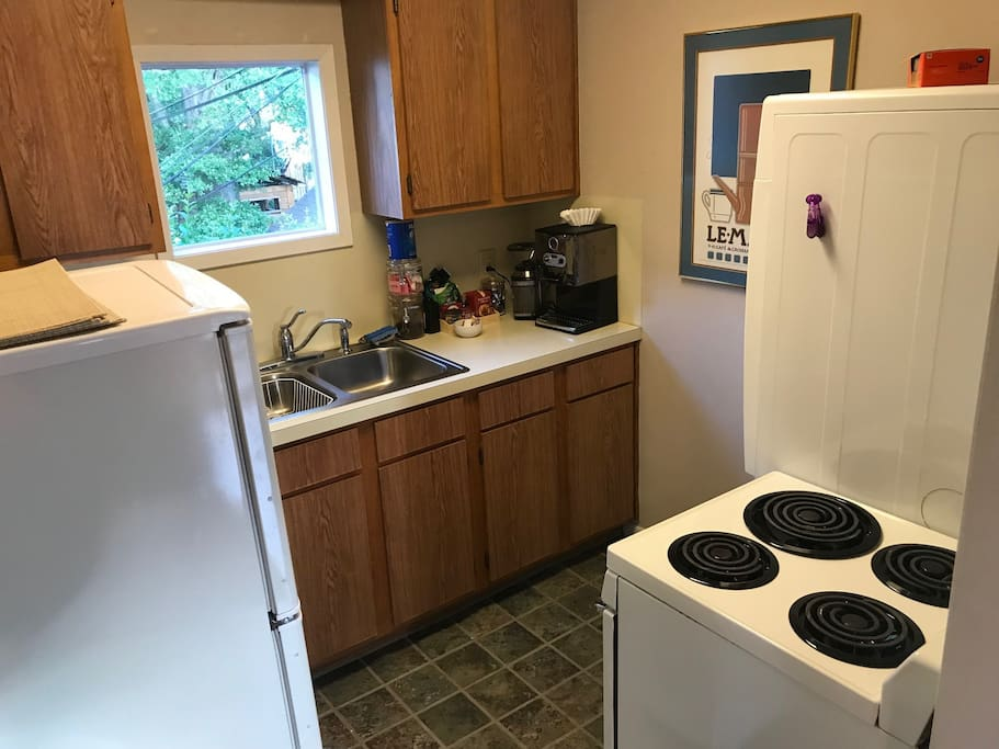 Full kitchen with coffee maker, microwave, stove and oven, frig and freezer, and washer dryer!