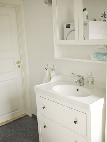 Bathroom with different stuff in drawers and cupboard