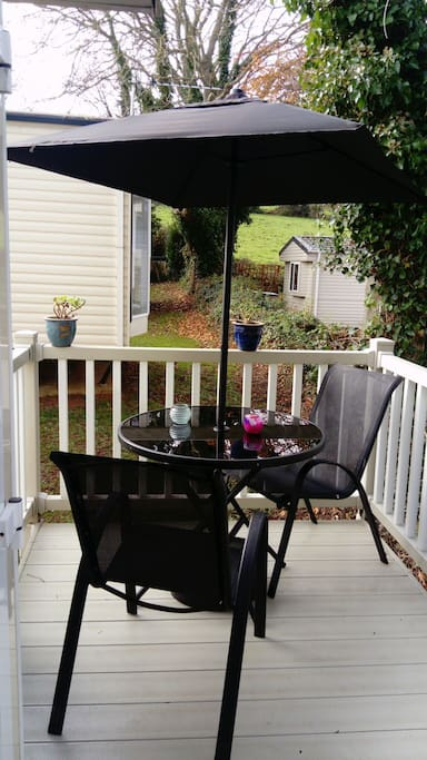 Veranda with Table Chairs and Parasol