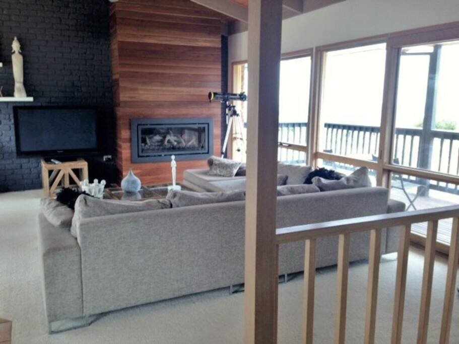 Open plan living upstairs, gas log fireplace