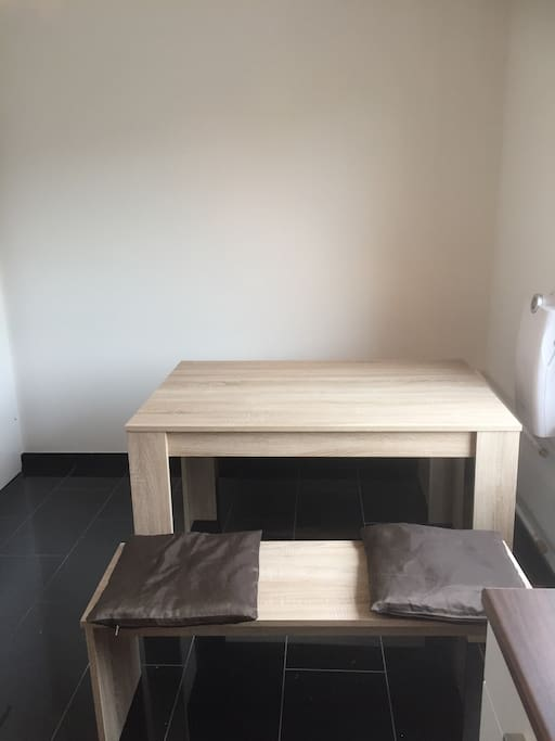 The dining table, next to the window, with two benches is suitable for 4 people. If desired/needed, we can add two (or more) chairs.