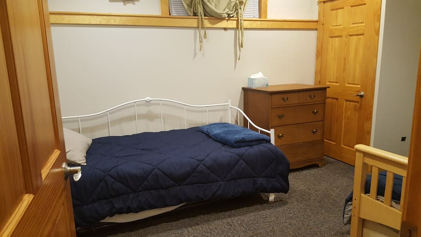 Bedroom #2 with 4 single beds. Two are trundles.