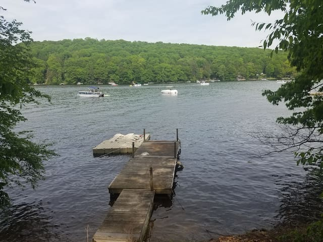 water craft slip to left. one boat, one jet ski.