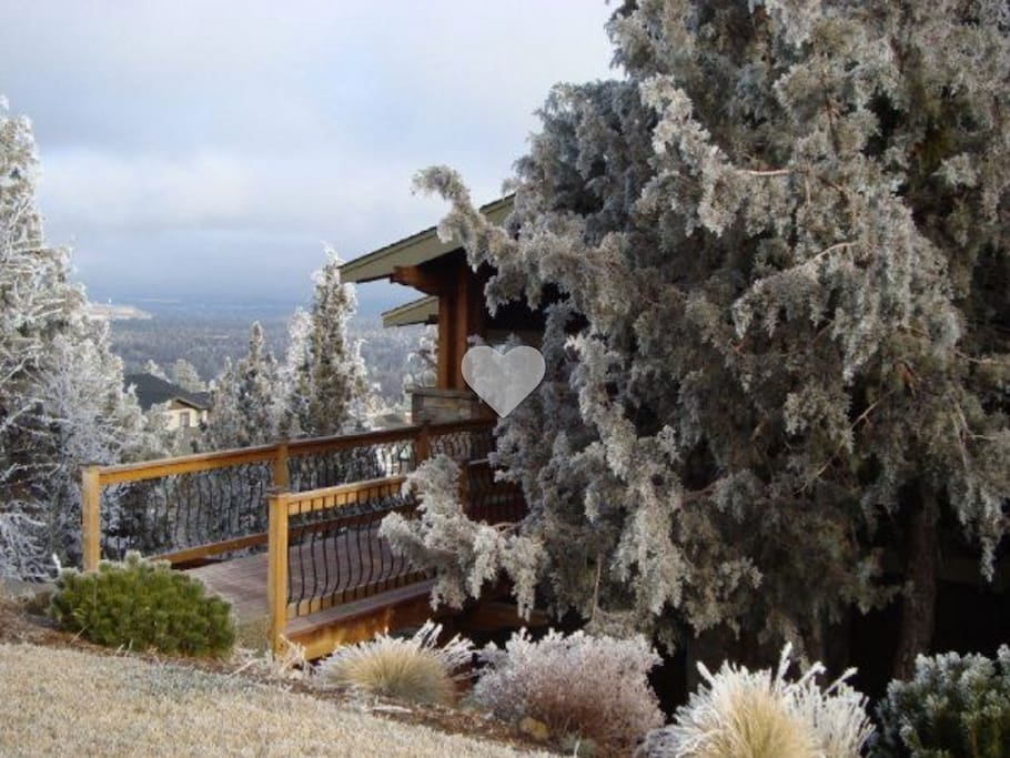 On the side of Awbrey Butte, the front of the home is sweetly hidden by local Juniper trees.
