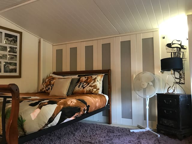 Double bed loft style bedroom Horse themed