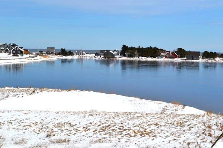 A view of the School House across the pond with the Atlantic on the  horizon