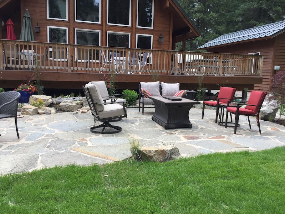 patio with fireplace and deck above