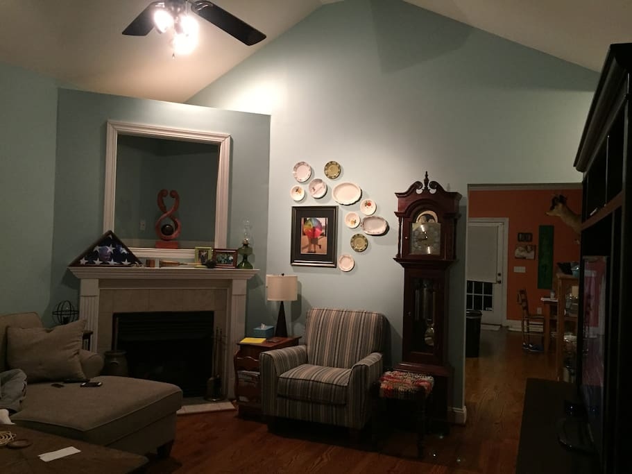 Living room, from the front door. (hallway to the left of the clock leads to the guest room)
