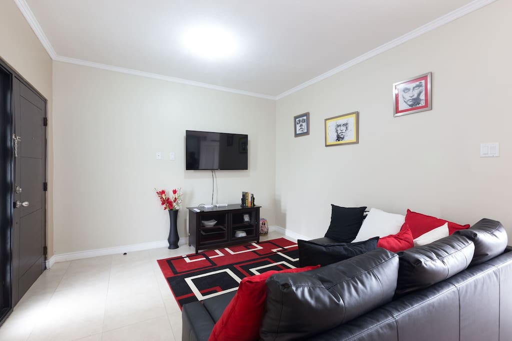 Tastefully decorated living room space with sofa bed, large TV & WIFI.