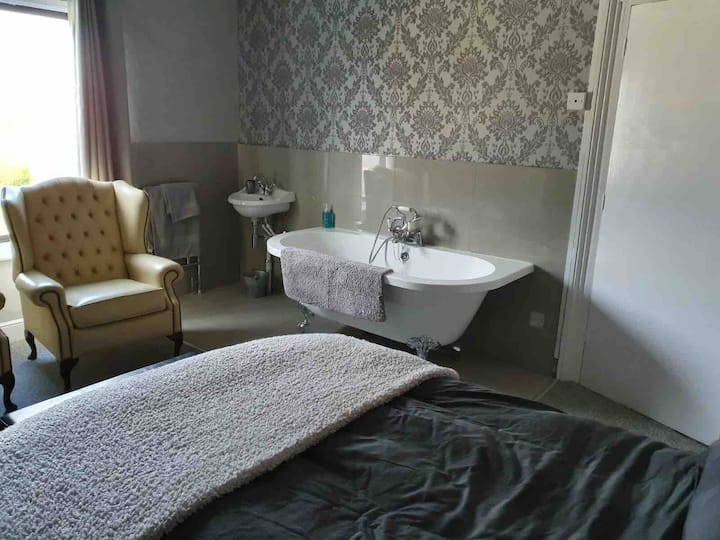 Refurbished room with roll top bath & Smart TV.
