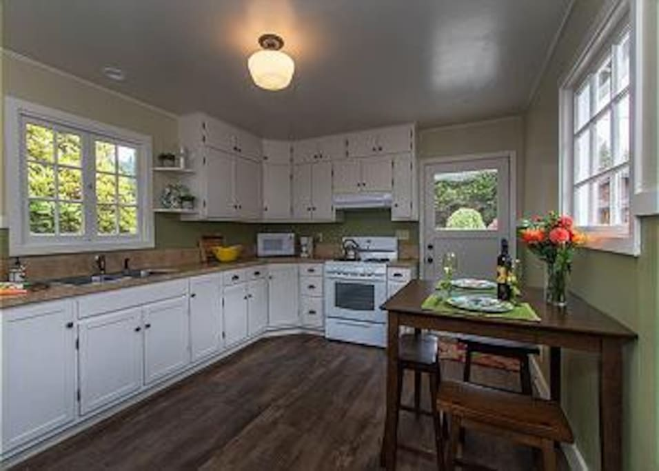 Cooking is delightful in this fully stocked kitchen with cafe style dining table