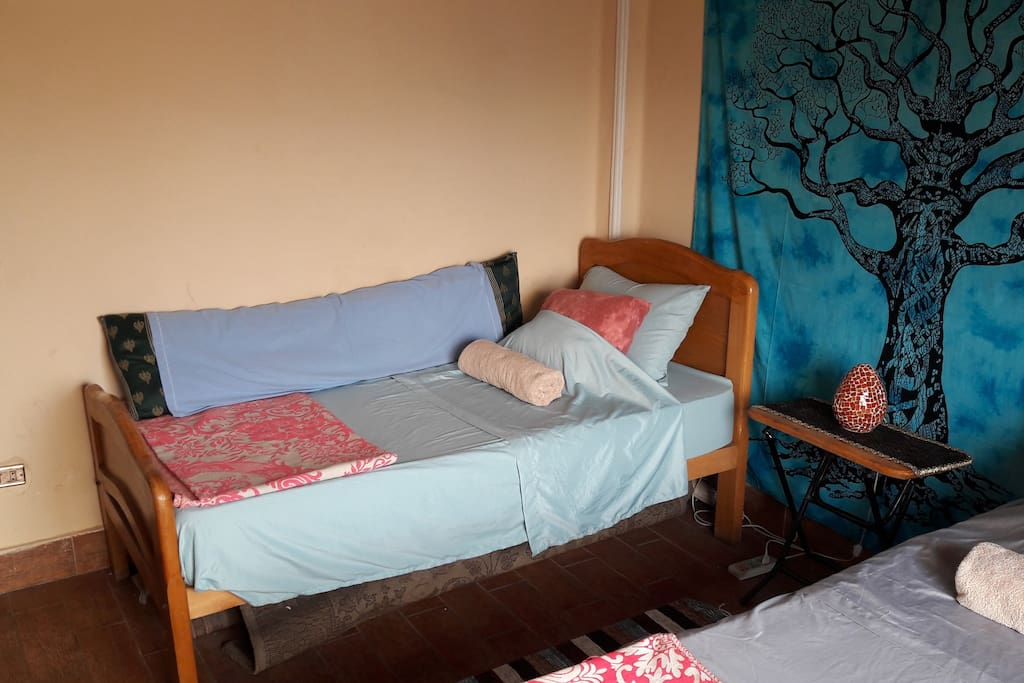 The other bed in the 2 twin bed guestroom with balcony overlooking the Nile