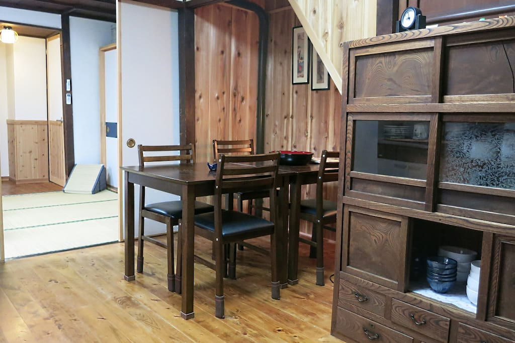 Small dining area. Behind it is the tatami bedroom with futon and adjoining bathroom.