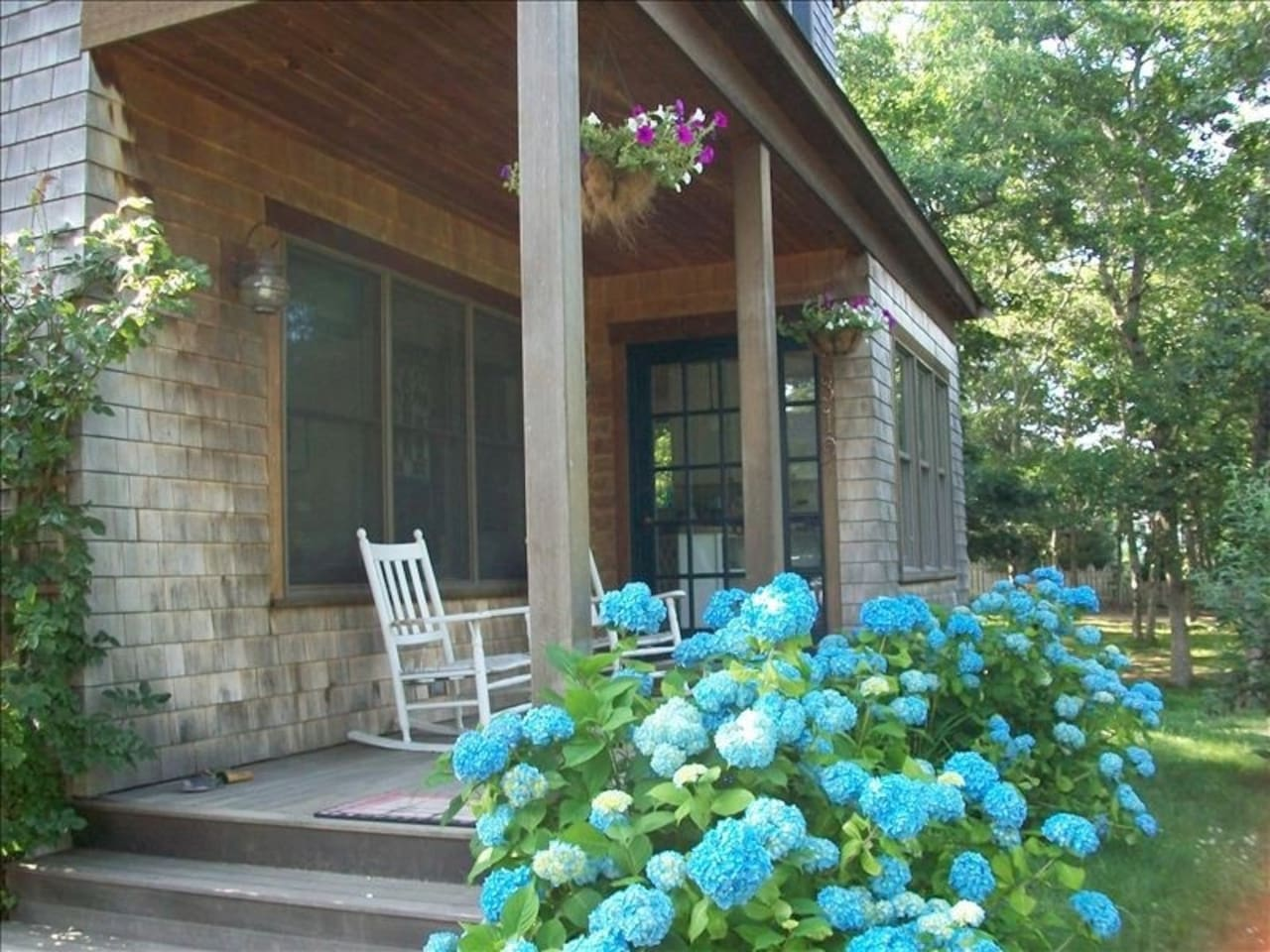 Front Porch with Two Rocking Chairs and Hydrangeas