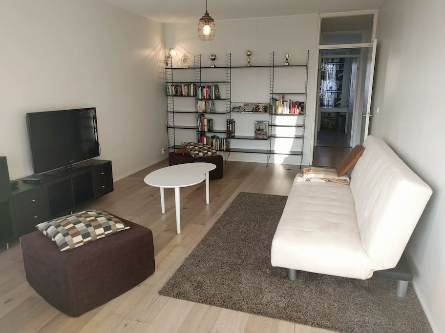 """Living room. """"Very good wifi, big appartment spacious for 4 people, nice furniture and decoration."""" (Guest)"""