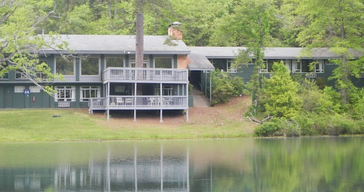 Great group housing overlooking small scenic lake.