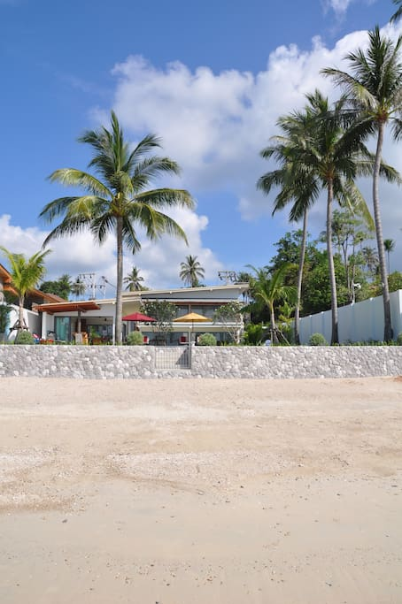 Direct private access to the uncrowded sandy beach.