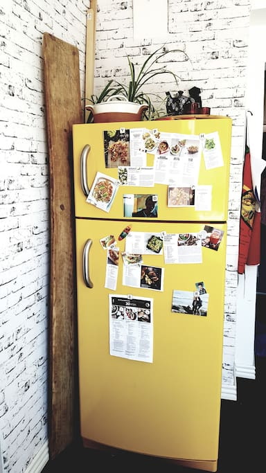 Full-size funny yellow retro fridge and freezer at your disposal