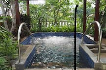 Hot water jaguzzi located right beside the swimming pool