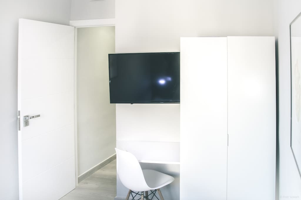 TV with HDMI and desk in your bedroom.