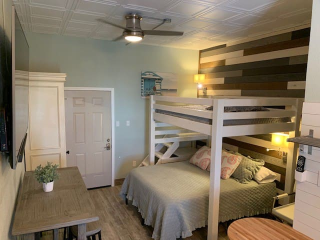 Full bed on loft, queen bed on bottom