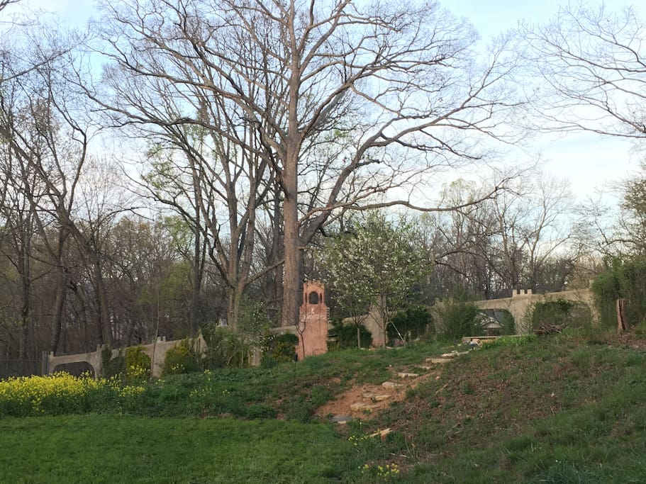 Large, private back yard with fire pit and bell tower.