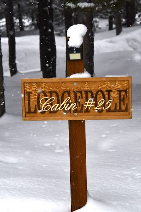 the Lodgepole sign by cabin driveway