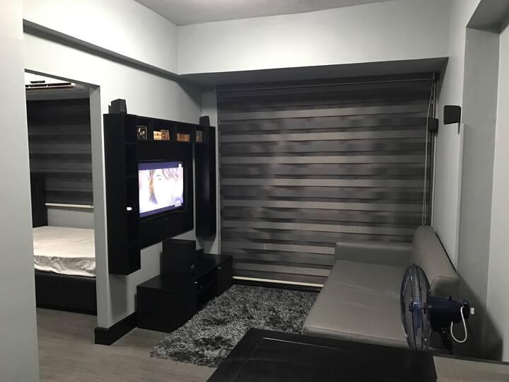 Modern Zen Studio Condo @ Forbeswood Parklane