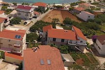 Aerial view of the house with nearby beach (100-metre walk).