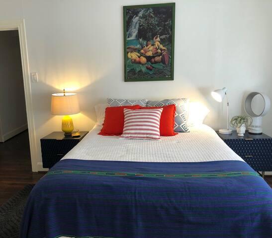 Second bedroom, queen bed, ceiling fan, and cedar closet.