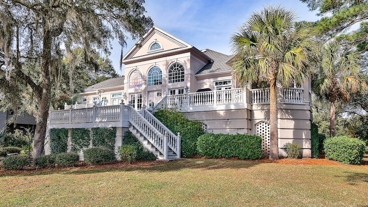 Experience luxury low country living at this beautiful golf course home featuring spacious porches to enjoy the gorgeous views of DeBordieu's 10th hole and ponds.