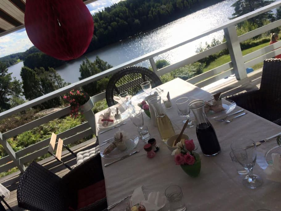 30 guests eating outside on the deck overlooking Lake Sillen!