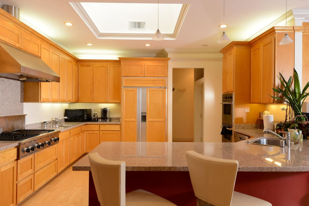 Custom Chef's Kitchen with 2 dishwashers, 2 sinks, top of the line appliances. Stocked with utensils, plates, glasses, etc.