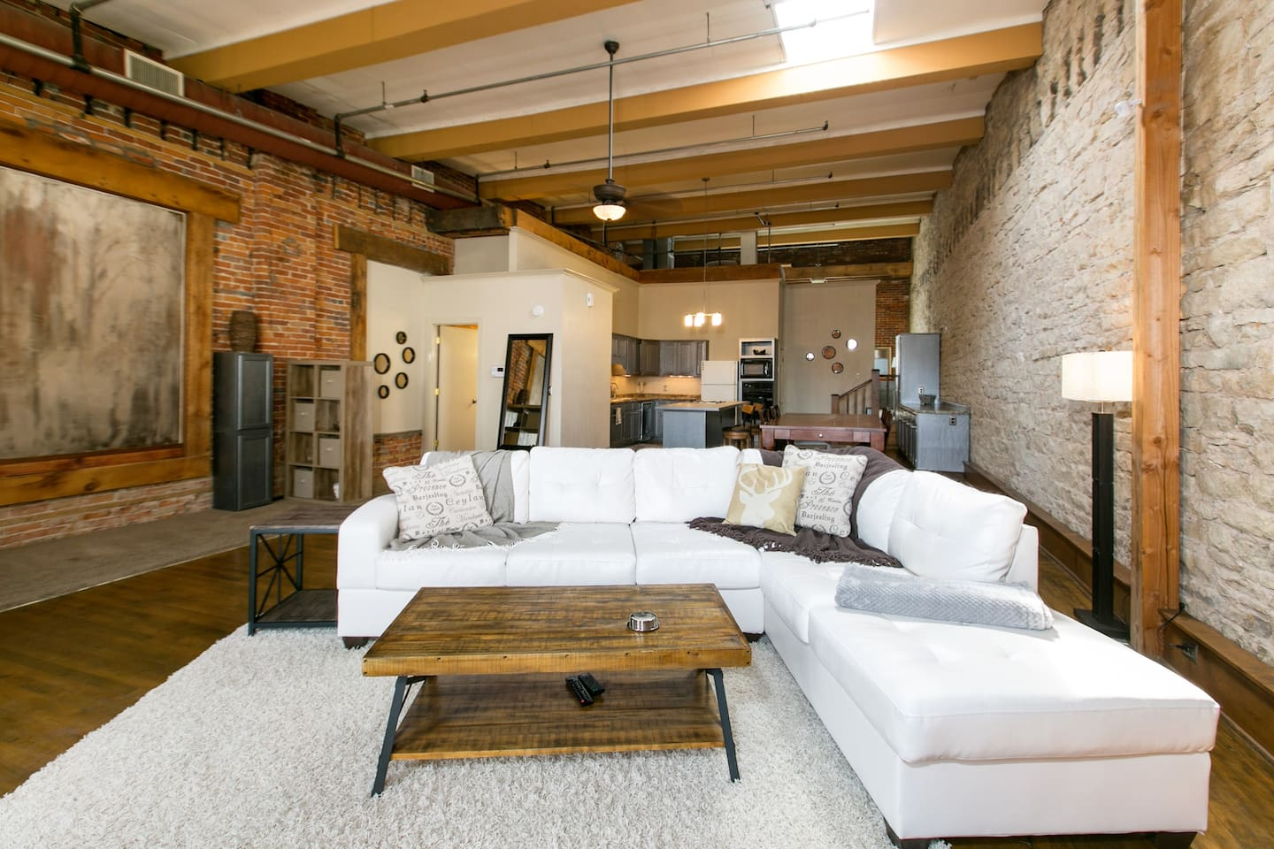 Open floor plan, true loft living! Gorgeous space for guests to feel comfortable with plenty of places to relax and still feel connected to the action.