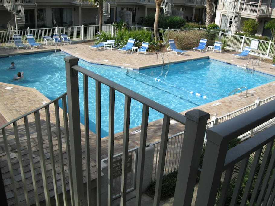 The pool is right at the bottom of the balcony steps