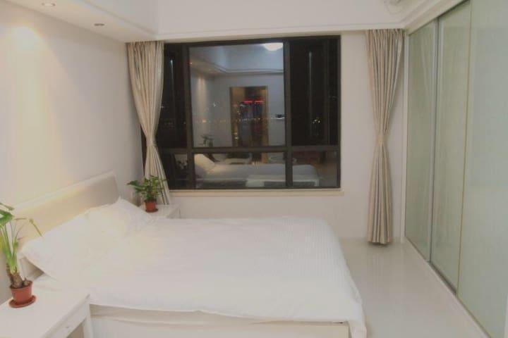 一线江景躺在床上看秋水广场音乐喷泉 - 南昌 - Apartment