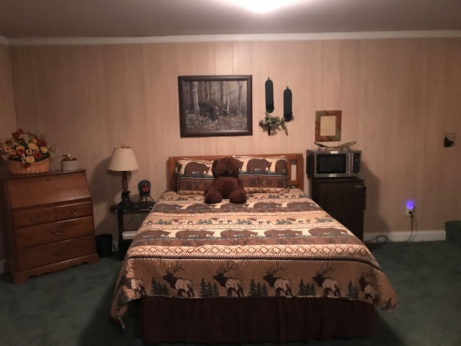 First queen bed in common area.  Refrigerator, microwave, coffee marker in this area. Coffee, tea bags, creamer, sugar, cups, provided.