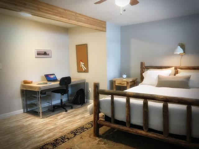 Enjoy a peaceful nights sleep in our hand-crafted Northwest style log bed.  The suite features an attached bathroom with bidet and jet tub, spacious walk-in closet, secondary closet,  and work area for your mobile office!