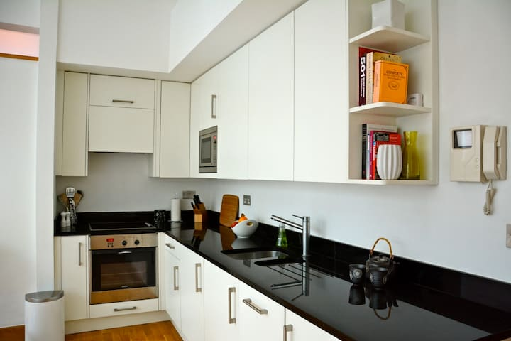 The kitchen area is fully equipped. It has dishwasher, full cooker with oven, microwave and washing machine/dryer. Plus all you need for catering ensuring a great stay.