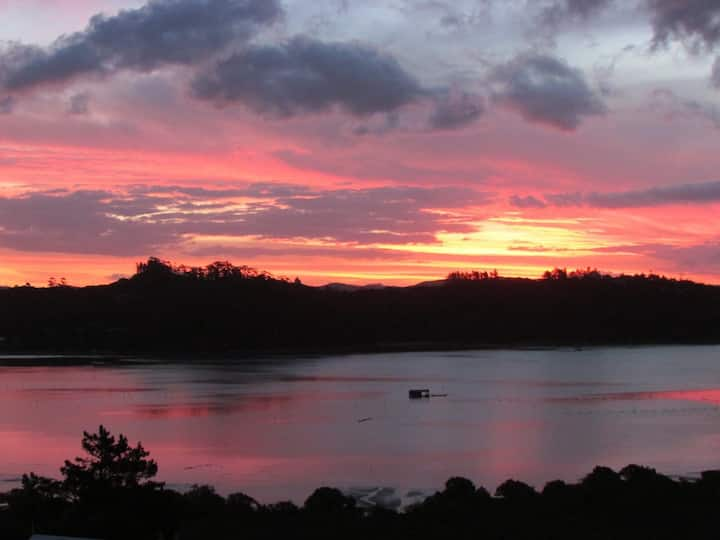 Russell. Glorious views of sunset across water.