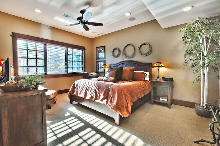 Large Master Bedroom with slope-side views, private bath with heated floor, steam shower and Jacuzzi tub.