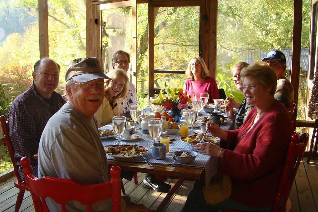 We serve breakfast, lunch and dinner on our screened in porch in spring and in front of the fire in the winter.