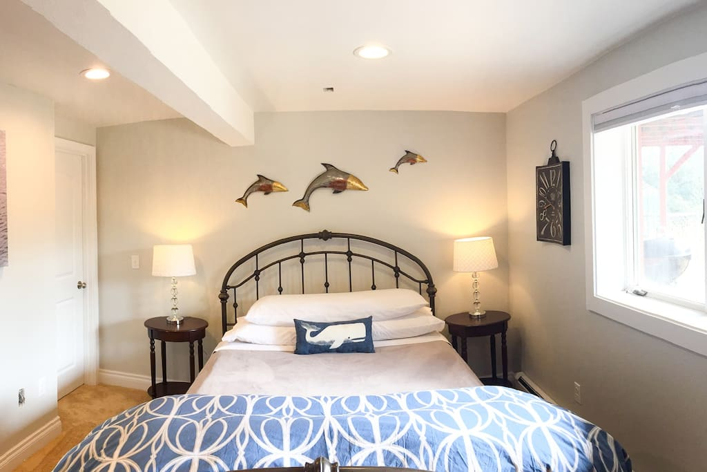 Newly remodeled Queen Suite with electric fireplace and private bathroom.