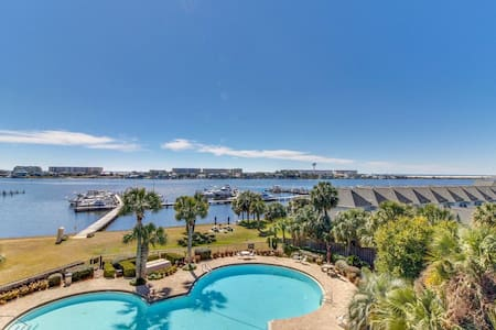 NEW! Waterfront condo w/ pool, marina & boat slip!