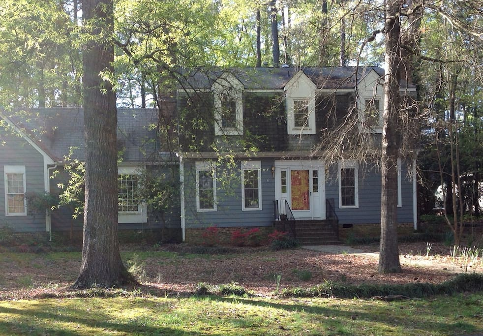 2 story house in quiet neighborhood. The house is on a large lovely wooded corner lot.