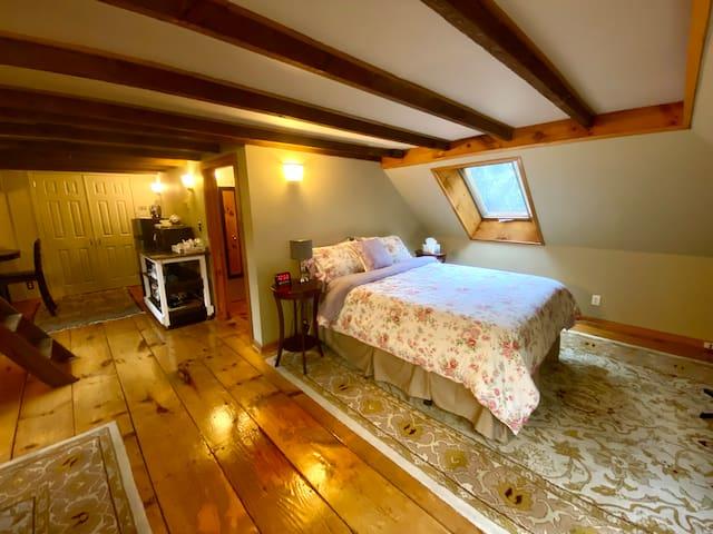 Sleeping area, door to bathroom, and kitchen/dining area.