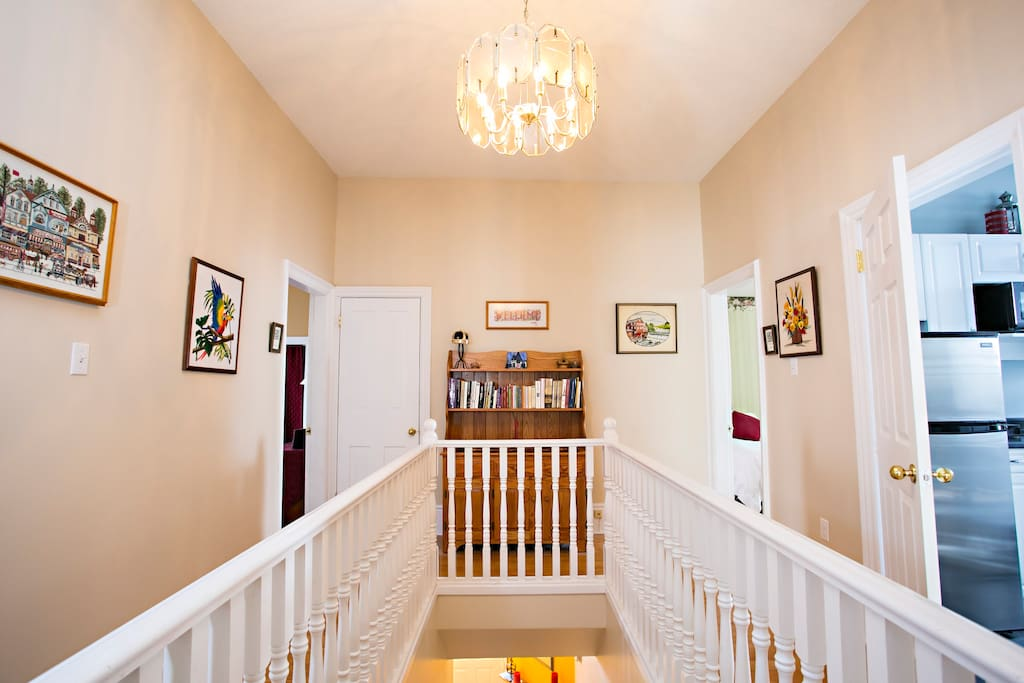 This historical  home has very high ceilings and wood floors. All upstairs rooms are  accessible from  the spacious  wrap around  hall.