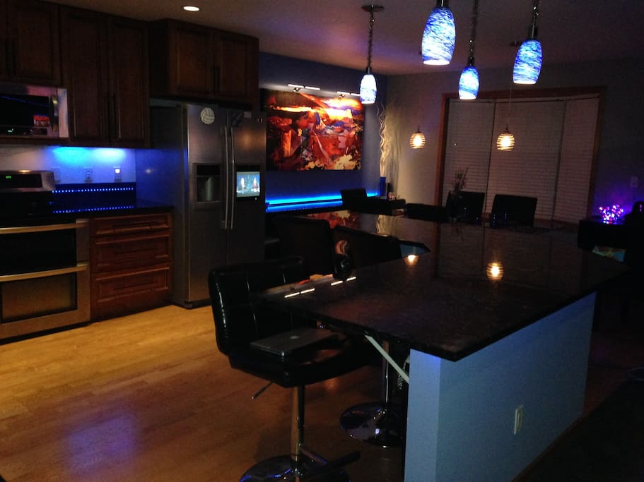 Island seats four. All lighting is color adjustable, touch faucet, HDTV in refrigerator