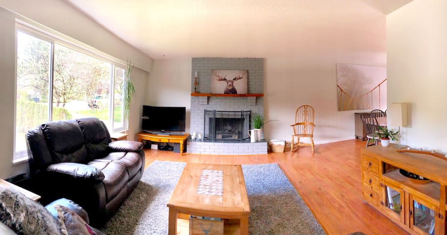 Living Room with recliner sofas and fireplace