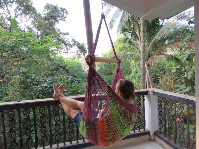 Comfy room with a private balcony in Arpora, Goa